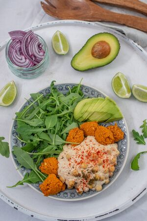 Avocado hummus salad bowl