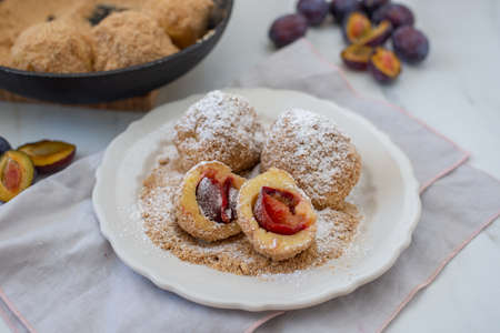 Typical Austrian plum dumplings made of leavened dough and fresh plums