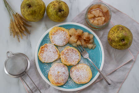 home made pancakes with cooked pears on a table