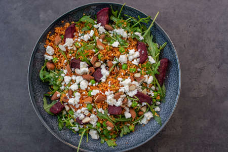 healthy home made couscous salad with sweet potato, beetroot and feta cheese