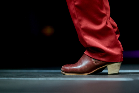 Dancing shoes feet and legs of male dance flamenco in a concert Stock Photo