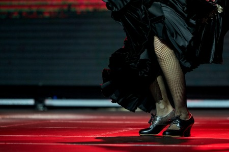 Woman legs dance flamenco black skirt and shoes in a concert Stock Photo