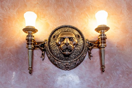 lionhead: Lion sculpture vintage decoration on the wall with lamp