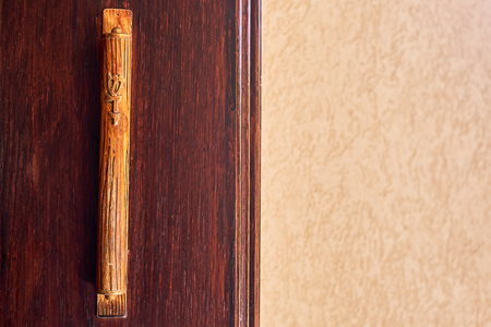 Mezuzah Made of wood near door from wood Stok Fotoğraf