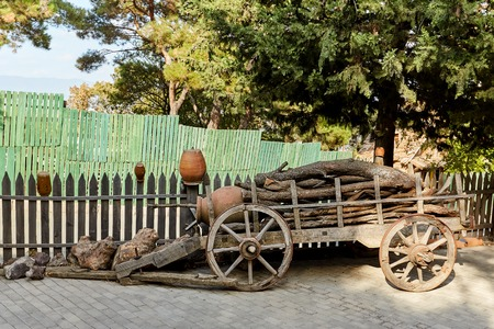 old wooden cart with clay pots on gravel base, gardening idea Standard-Bild - 108019601