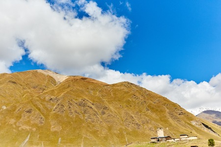 mountains in Georgia and blue sky Standard-Bild - 108080576