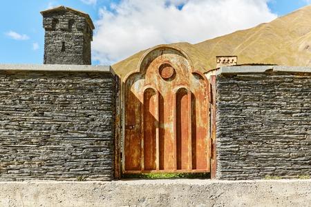 rusty old door in the wall of an old monastery in Georgia Standard-Bild - 108072298