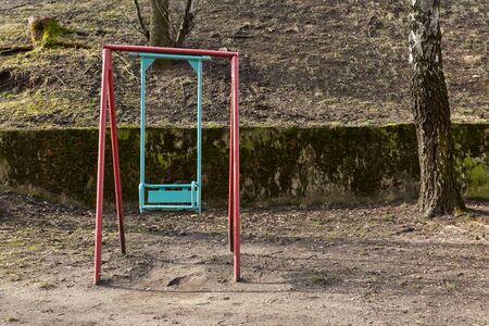 old swing in the yard sunny day Standard-Bild