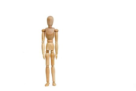 wooden mannequin for drawing stands on a white background