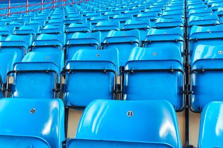 empty bleachers and chairs in blue indoor 版權商用圖片 - 143753033