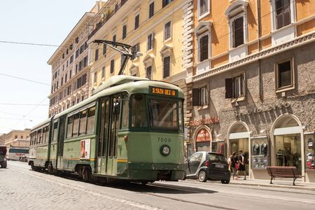 Rome, Italy, May, 18, 2015. A green tram rides along an old street on a sunny day
