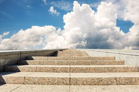 Long stone stairway to cloudy heaven on a sunny day