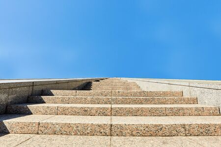 long stone staircase leading up on a sunny day