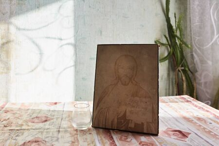 Icon depicting Jesus Christ stands on a table on a sunny day Standard-Bild