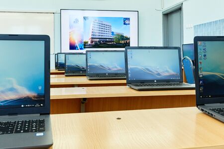 Minsk, Belarus, April, 6, 2020. A row of laptops stands on the tables in the office daylight