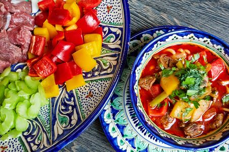 Soup with vegetables and meat in a colored bowl chopped foods Standard-Bild