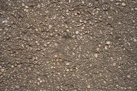 Texture of an asphalt road. Close-up background. Top view.