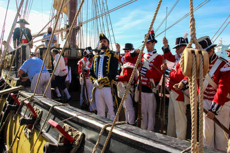 Malaga, Spain - October 26, 2014: Captain of the Royal Navy in the 18th century on a ship with his crew of marines and seamen. Reenactors on a brig with cannons. Editoriali