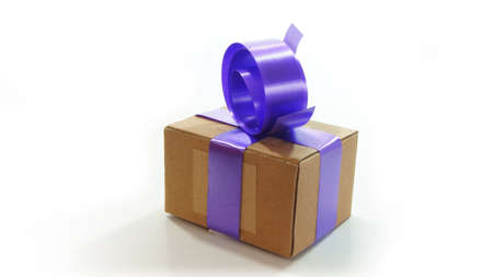 giftwrapped: Corrugated cardboard box wrapped with violet ribbon on white background
