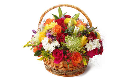 Basket with colorful flowers on white background
