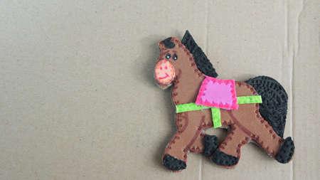 Horse made of foamy on cardboard - School children work