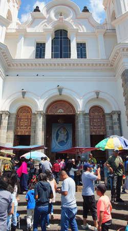 part of me: El Quinche, Pichincha  Ecuador - 13 de noviembre 2016: Actividad en la entrada del santuario de la Virgen de El Quinche. Papa Francisco I visitó esta iglesia como parte de su agenda en Ecuador en 2015 Editorial