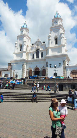 part of me: El Quinche, Pichincha  Ecuador - November 13 2016: People walking in front of Sanctuary of the Virgin of El Quinche. On July 8, Pope Francisco I visited this church as part of his agenda in Ecuador Editorial