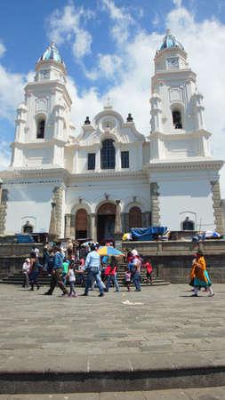 part of me: El Quinche, Pichincha  Ecuador - 13 de noviembre 2016: La gente que camina delante del santuario de la Virgen de El Quinche. El 8 de julio, el Papa Francisco I visitó esta iglesia como parte de su agenda en Ecuador