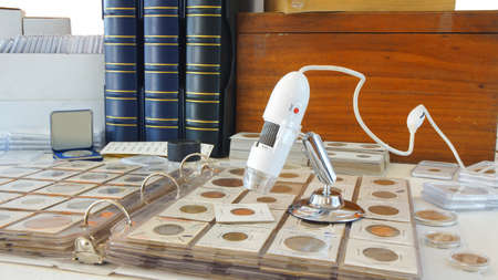 Digital microscope on album with coins from different countries - Numismatic scene