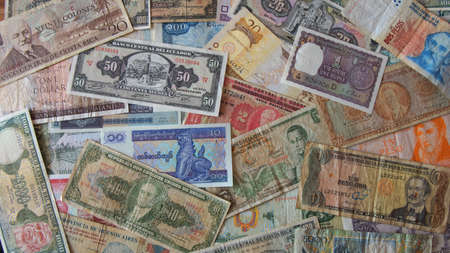 numismatics: Lot of old banknotes of different countries of the world disordered as background - Numismatics scene