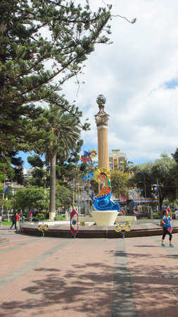 xx century: Ambato, Tungurahua  Ecuador - December 17 2016: People walking in the 12 de Noviembre Park. This place was a strategic point for the commerce of the city in century XX