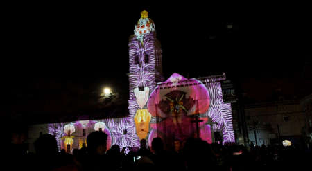 Quito, Pichincha  Ecuador - August 9 2017: Crowd admiring the spectacle of lights projected on the facade of the Church of Santo Domingo, in the historical center of Quito. Fiesta de la Luz is an event that takes place in Quito every August Editorial
