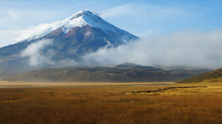 View of Limpiopungo lagoon with volcano Cotopaxi in the background on a cloudy morning - Ecuador