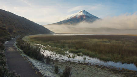 View of Limpiopungo lagoon with volcano Cotopaxi in the background on a cloudy morning - Ecuador Stock Photo