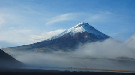 View of the north face of the Cotopaxi volcano on a cloudy morning - Ecuador Stock Photo