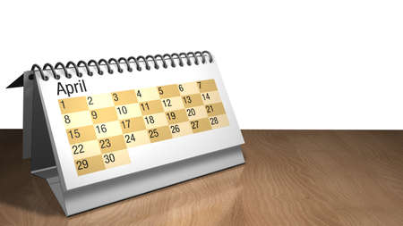 3D model of a April desktop calendar in white color on a wooden table on white background- 3D render Stock Photo