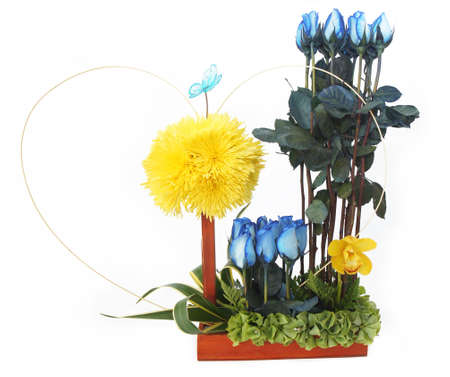 Floral gift arrangement made with blue roses with long stems and yellow flowers inside a wooden pot on white background