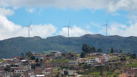 Panoramic view of the city of Loja in Ecuador with wind turbines on the horizon