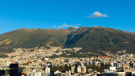 Panoramic view of the central area of the city of Quito with the Rucu Pichincha in the background on a sunny morning