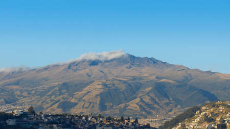 Panoramic view of the Atacazo volcano with blue sky in the background on a sunny morning