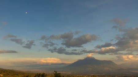 Panoramic view of the Imbabura volcano located next to Lake San Pablo at sunset. Imbabura - Ecuador