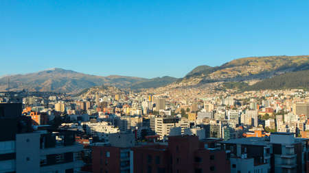 Panoramic view of the central area of the city of Quito with the Atacazo mountain in the background on a sunny morning Stock Photo