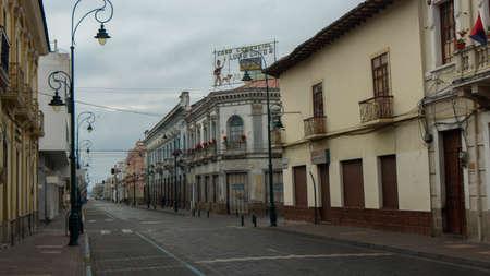 Riobamba, Chimborazo / Ecuador - February 10 2019: People walking down a street in the historic city center