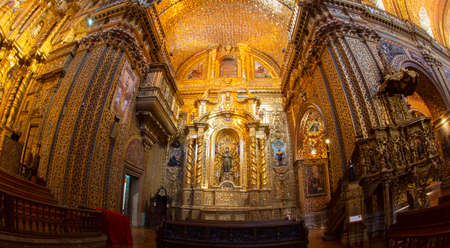 Quito, Pichincha / Ecuador - November 1 2019:  Front wide angle view of the altar of the Church of the Society of Jesus, known colloquially as la Compania, is a Jesuit church Editorial