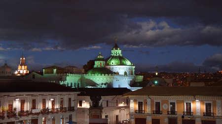 Quito, Pichincha / Ecuador - September 8 2018: Panoramic view of the dome of La Compania de Jesus in the historic center of Quito at night