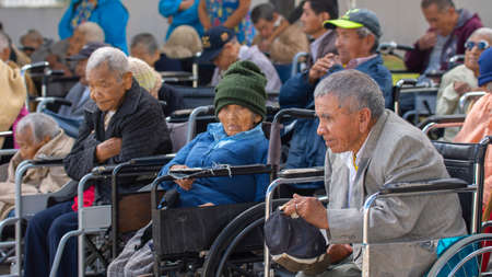 Conocoto, Pichincha / Ecuador - June 12 2019: Group of wheelchair users gathered during an event in a hostel for the helpless Editorial