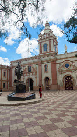 Inmaculada Concepcion Loja, Loja / Ecuador - March 30 2019: Woman walking in the plaza of the foundation with the church of San Francisco in the background Editorial