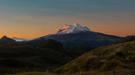 Panoramic view of the Antisana volcano at sunrise from the Papallacta highlands in the Ecuadorian Andes