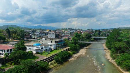 Tena, Napo / Ecuador - October 10 2020: Panoramic view of the city of Tena with the bridge over the Napo river