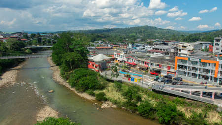Tena, Napo / Ecuador - October 10 2020: Panoramic view of people walking on the boardwalk of the Napo river in the city of Tena in the Ecuadorian Amazon